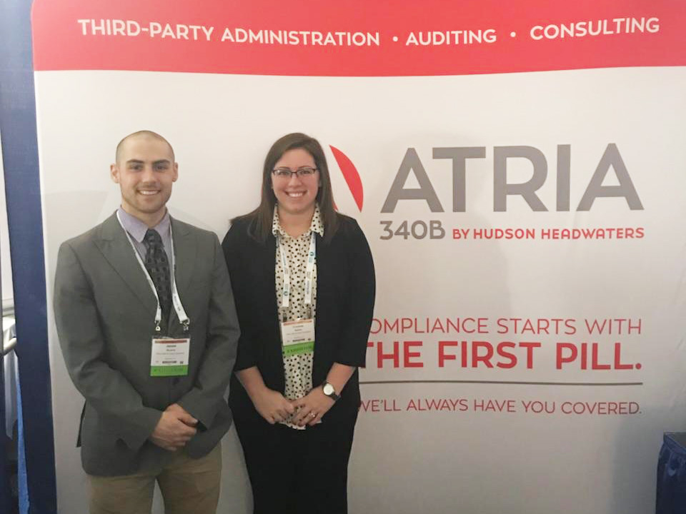 Chelsey Baldwin and James Sipowics at the ATRIA 340B Conference Booth