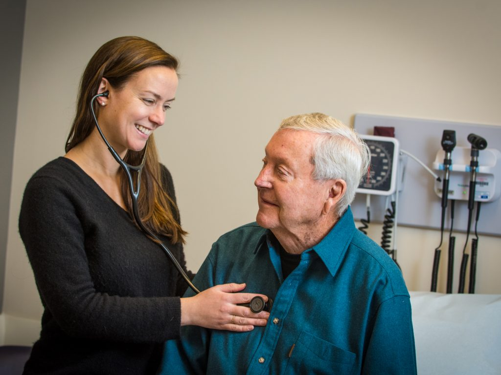 a HHHN provider examines an elderly patient